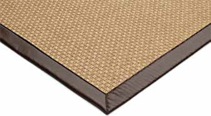 Acabado mediante cinta en alfombras